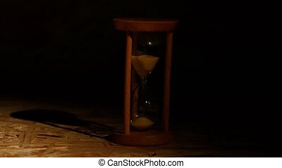 Grains of the hourglass fall down - Sand falls quickly...