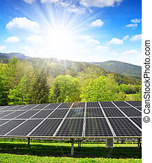 Solar panels in spring landscape. Clean energy.