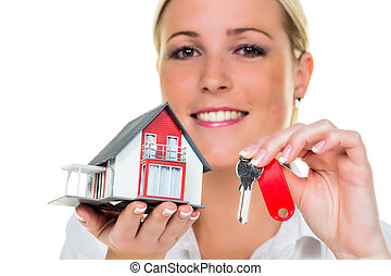 real estate agent with house and schlü�el
