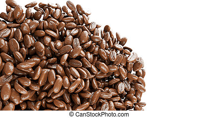 roasted coffee grains falling and mixing