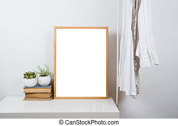 Empty wooden picture frame on the table, art print mock-up -...