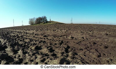 Bare soil spring nature - Camera on steadicam over plowed...