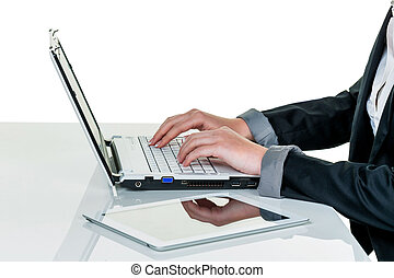 woman in office with laptop com puter - a woman working in...