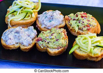 Italian Cicchetti Italian snacks on brad like bruschetta -...