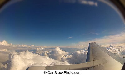flying above the clouds - flying over white clouds - view...