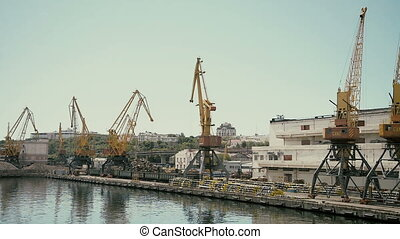 Industrial port cranes in Odessa, Ukraine. Black sea port -...