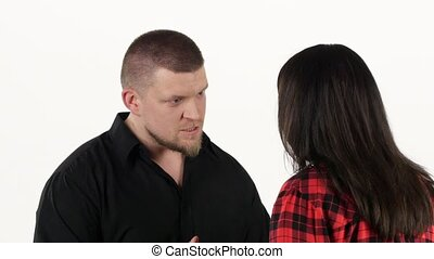 Man swears to his woman and gesturing with hands. White