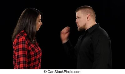 Angry man shouting and shaking woman Black Close up - Angry...