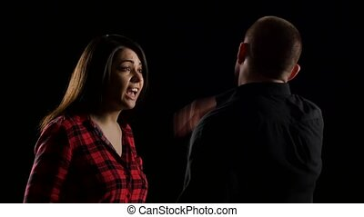 Woman during an argument does slap her man. Black -...