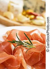 Prosciutto, italian cured ham - Slices of delicious...