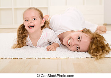 Woman and little girl playing and having fun - Woman and...