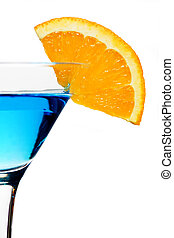 Blue cocktail drink with orange slice isolated on white