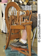 Spinning Wheel - An spinning wheel used in the manufacture...