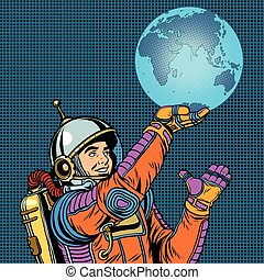 Retro astronaut is holding the planet Earth on hand pop art...