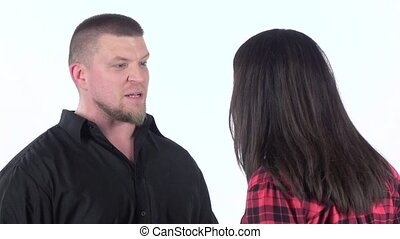 Irritable man yells at woman and grabs her by shoulders. Slow motion
