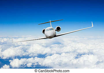Private jet plane flying above clouds, shot from front view