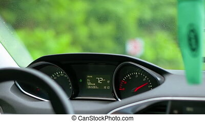 Man Driving a Car Through the Village - Caucasian man...