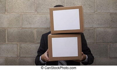 Businessman Looking From Behind Box - Businessman waiting in...