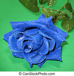 Blue Rose 2 - An artificial blue rose with dewy petals on a...