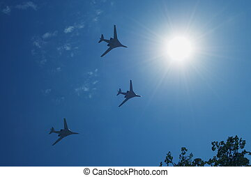 Towards the Sun - Three jet planes flying in the blue sky