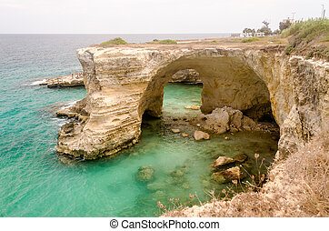 Scenic rocky cliffs of Torre Sant Andrea, Salento, Italy -...
