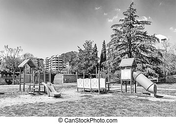 Deserted playground for kids inside a urban public park, Italy