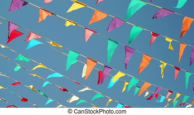 String Pennant Flags Against Sky - Panning shot against a...