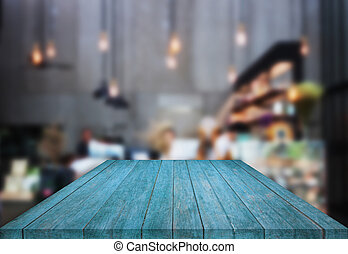 Blue table top wooden with blurred background in coffee shop