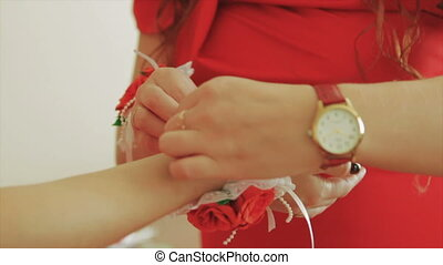 Young Women Wears a Bracelet on a Hand. Close up
