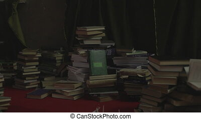 Big pile of old books pan shot clip