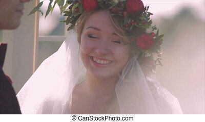 Bride With Tenderness Looks at The Groom Closeup