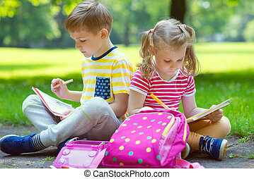 Two happy children in park - Two happy children drawing in...