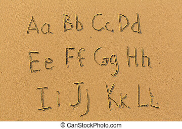 Alphabet letters drawn on beach sand (A-L, 1/2)