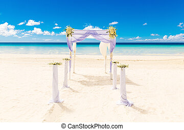 Wedding on the beach . Wedding arch decorated with flowers on tropical sand beach.