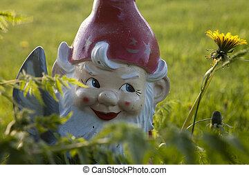 Garden Gnome - Rundown garden gnome early Spring almost...