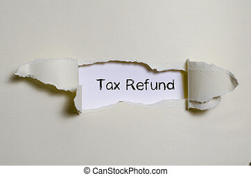 The word tax refund appearing behind torn paper