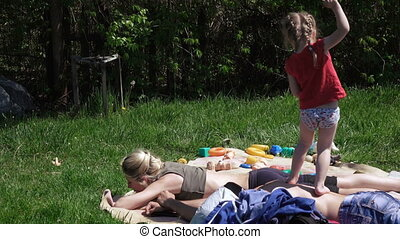 Girl with parents on picnic - On carpet is Mom and Dad....