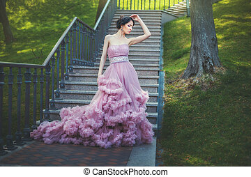 Lady in the lush dress. - Slender Lady is walking in the...