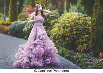 Woman in a beautiful dress walks in the park. - Woman in a...