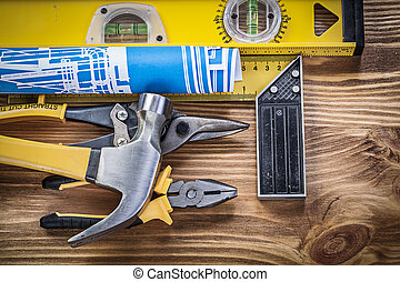 Set of construction tools on wooden board top view