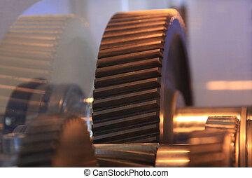 Closeup of metal gears - open helical gear in the gearbox...