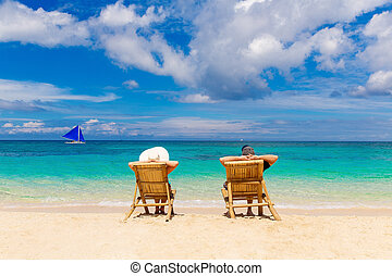 Beach summer couple on island vacation holiday relax in the...