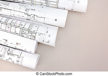 architect work table with blueprint rolls