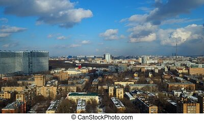 Partly cloudy winter time lapse with distant Ostankino TV...