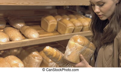 Customer chooses the bread in a supermarket - Customer...
