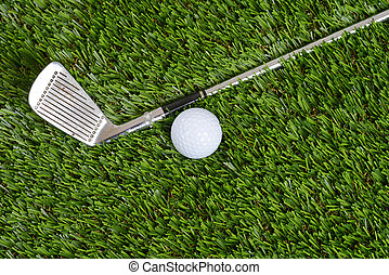 top view golf wedge club and ball on grass
