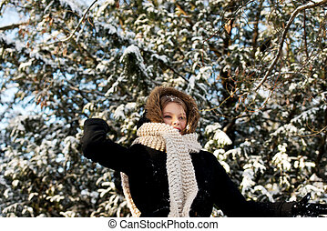 Young woman throwing snowball - Teenage woman playing...
