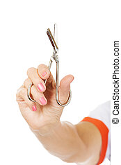 Elderly female doctor or nurse holding scissors