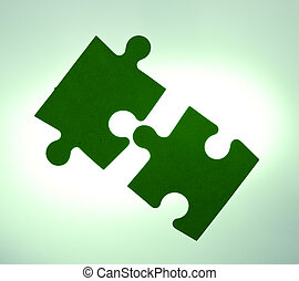 Backlit puzzle pieces - solution concept - Backlit green...