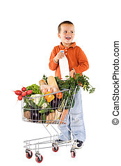 Little boy with basic healthy food in shopping cart laughing...
